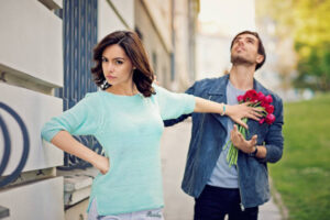 Young is girl is rejecting boy on the street.