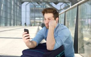 A guy waiting for a woman to pick his phone call.