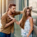 A girl ignoring a man