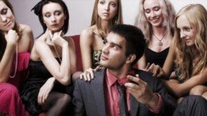 Attractive women surrounding a bad boy