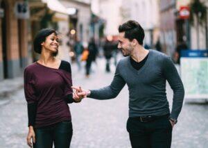 A man touching a woman