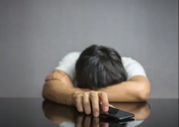 A man frustrated because a woman she likes is texting back