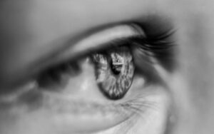A dilated pupil of a woman