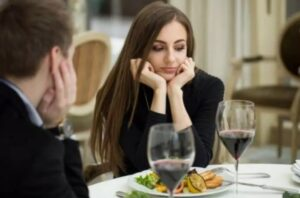 A man with a woman on a first dinner date