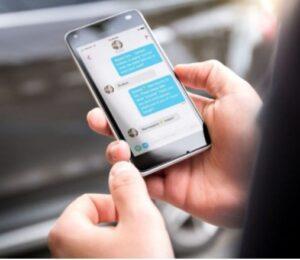A man texting his girlfriend