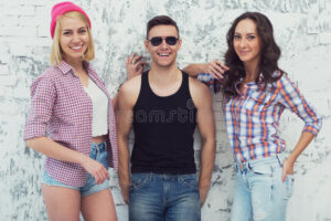 A man surrounded by attractive women