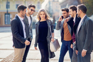A shot of a group of guys looking at a woman
