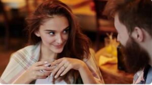 A woman flirting with a man on a date